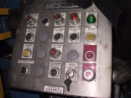 picture of the control panel with lockout switch and line jog button at #3 bridle roll set of the tinning line