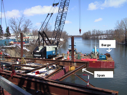 Overview of the barge and workstation where the temporary bridge span was placed and being dismantled.