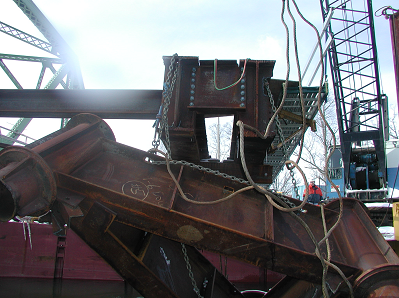 photo of the pile cap hung by the test chains after it broke apart from the W36 I-beams.