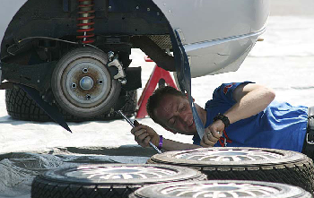 picture of mechanic repairing rear brakes