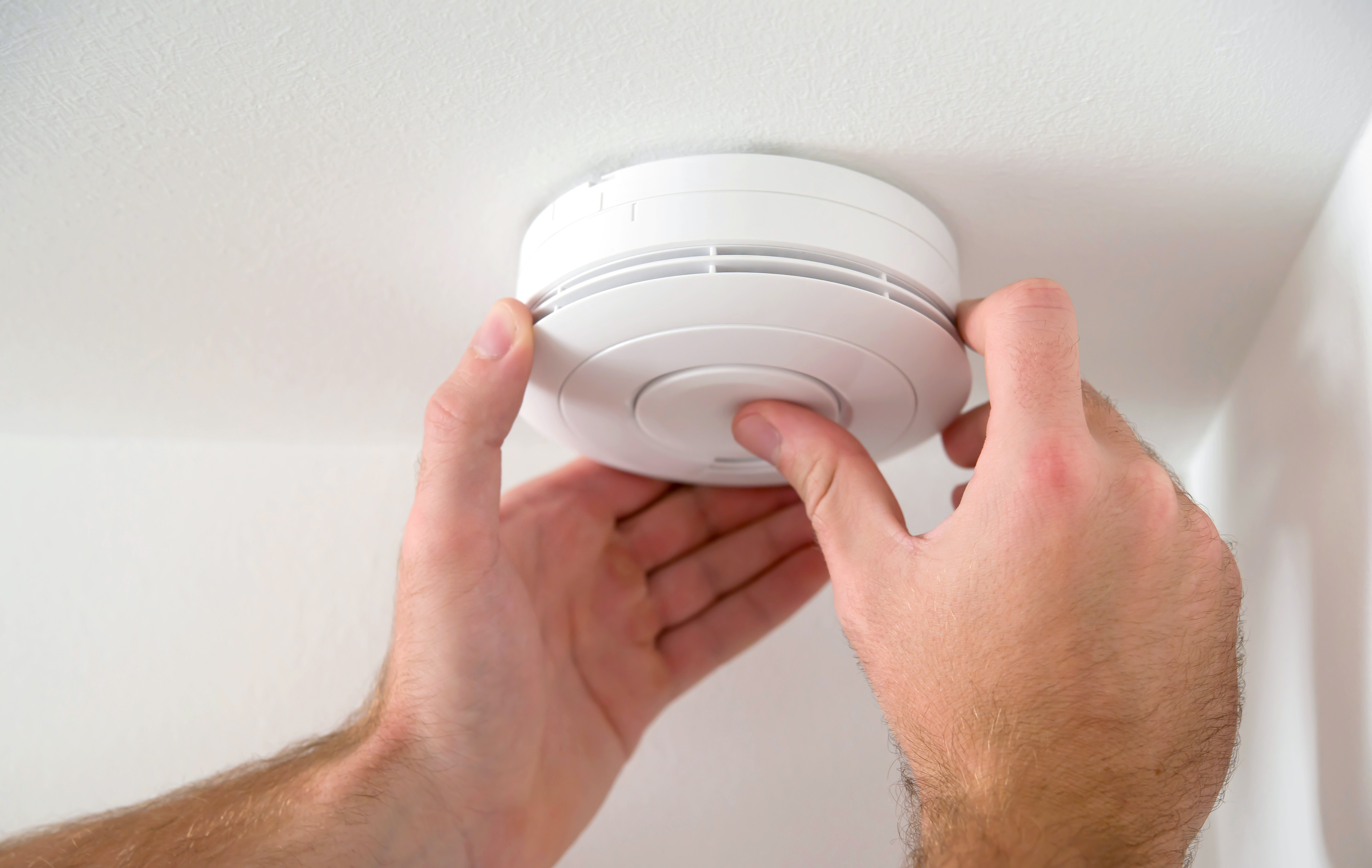 picture of person installing CO detector