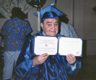 George Malatesta of the Park Inn Adult Home in Far Rockaway celebrates his graduation with fellow residents.